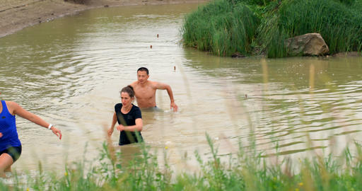 Front view of fit Caucasian people jogging in water at countryside 4k Live Action
