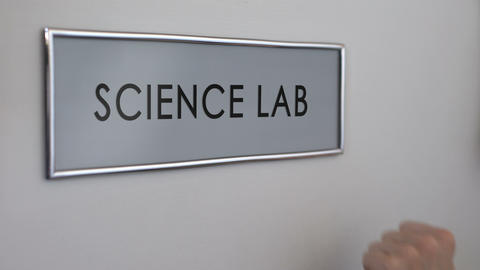 Science lab door, hand knocking close up, chemical experiments, biology research Live Action