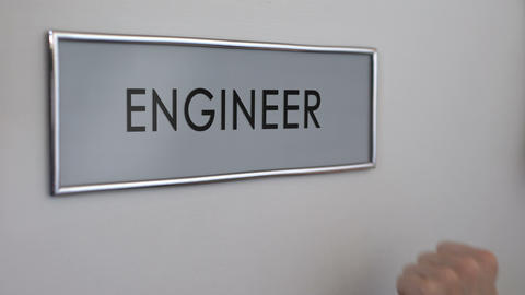 Engineer office door, hand knocking closeup, construction building and design Live Action