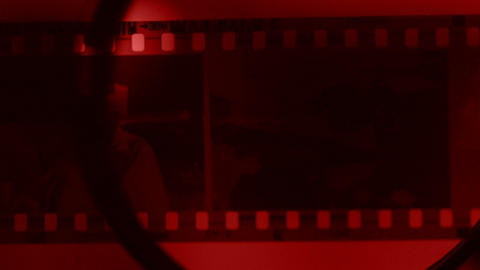 Secret agent checking film photos in archive, trying to identify danger criminal Live Action