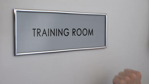 Training room door, hand knocking closeup, business conference, company seminar Live Action