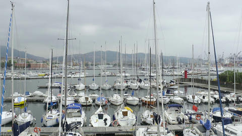 Recreational motor boats in yacht club of Spezia, European morning harbor view Live Action