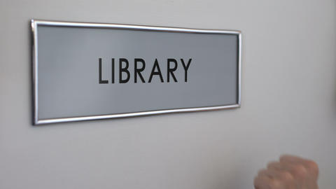 Library office door, hand knocking, university education, books collection Footage