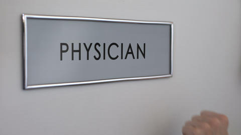 Physician room door, hand knocking closeup, disease treatment, medical care Live Action