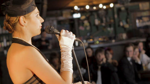 Beautiful female jazz singer performing song at restaurant, celebration event Footage
