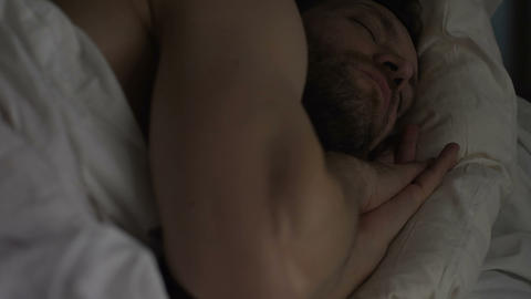 Calm bearded man sleeping in bed, breathing with open mouth, healthy sleep Live Action