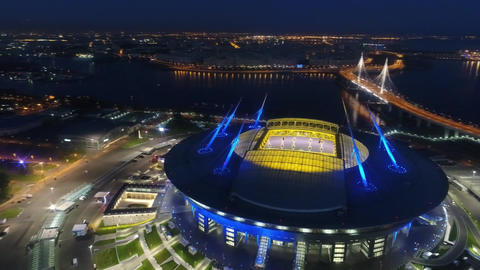 Stadium Zenith Arena at night. Illuminated by multi-colored lights the stadium Live Action