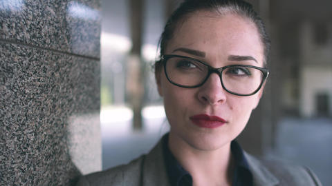 Business woman with glasses. Close-up. 4k Footage
