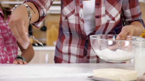 Close up of Woman spreading flour on the table Live Action