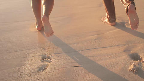 Happy newlywed couple running on the beach Footage