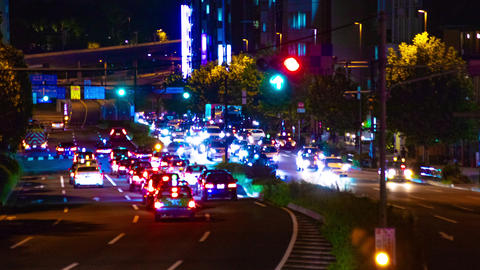 Night busy street at Aoyama avenue time lapse middle shot right panning Footage