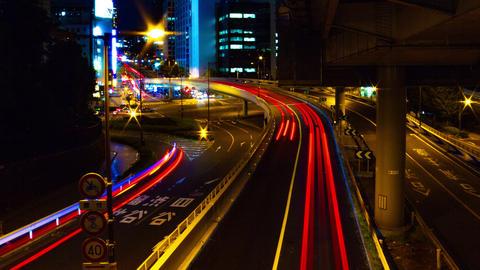 Night time lapse at Akasaka intersection wide shot slow shutter left panning Footage