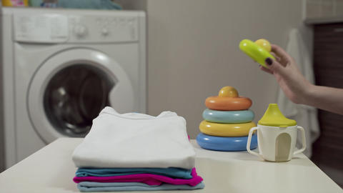 Clean baby clothes at the laundry, in the laundry, washday, using the washer ビデオ