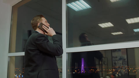 Successful business man calling to mobile phone on… Stock Video Footage