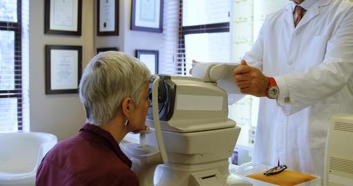 Optometrist examining patient eyes with autorefractors 4k Live Action