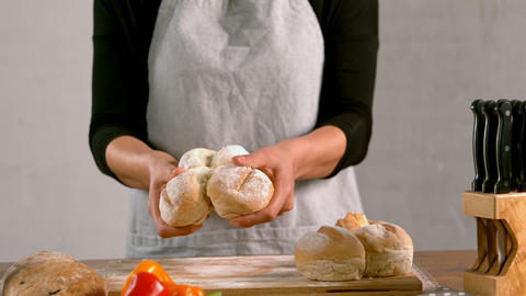 Woman holding loaf of bread 4k Live Action