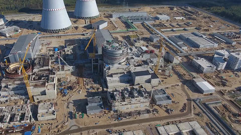 Aerial survey of a nuclear power plant under... Stock Video Footage