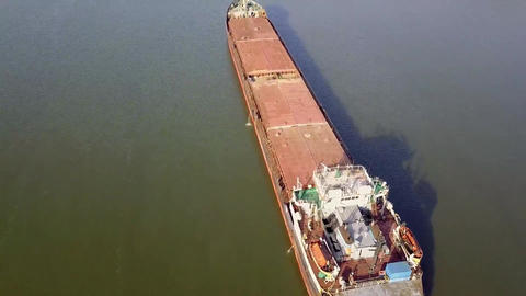 A cargo barge floats along the river. Cargo ship. River port cargo. Tower cranes Live Action
