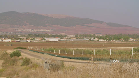 Border fence between Israel and West Bank. barbed wire electronic fence ビデオ