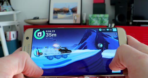 Man Playing A Racing Game On His Modern Smartphone Footage