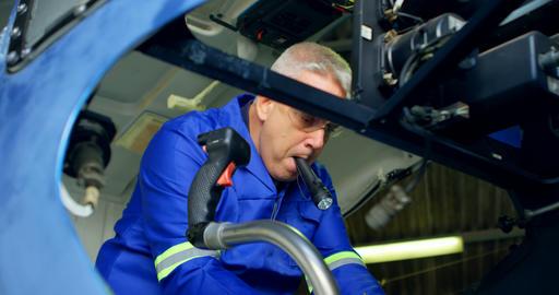 Engineer repairing an aircraft in hangar 4k Live Action