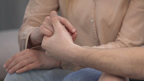 Male taking wife hand in trouble period, friendship support and care, assistance Live Action