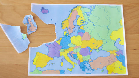 Stop motion of a torn paper map symbolizing the UK leaving the European Union or Footage