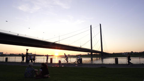 Young Happy Couple Rest on Rhine River Bank Sunset, Dusseldorf, Germany ビデオ