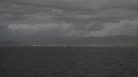View from the cruise ship to the rocky shore, ships, clouds at dusk, the ship ビデオ