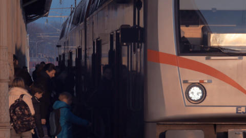 Train station. The passengers are boarding into the train Footage