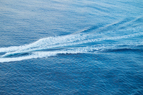 Boat track on the sea, white foam, blue waves, beautiful background フォト
