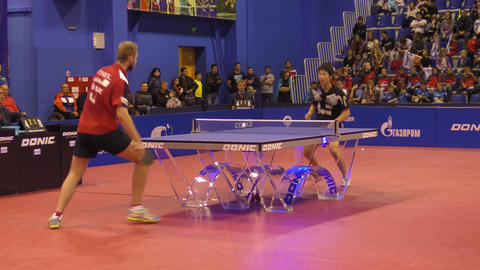 Orenburg, Russia - September 28, 2017 year: boy compete in the game table tennis ビデオ