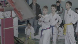 The boy athlete makes a kick during a training session in Taekwondo Footage