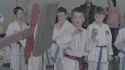 Training in Taekwondo in children. Children's sports. Slow motion Footage