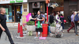 Chinese lady singing in street at Chinatown London Footage