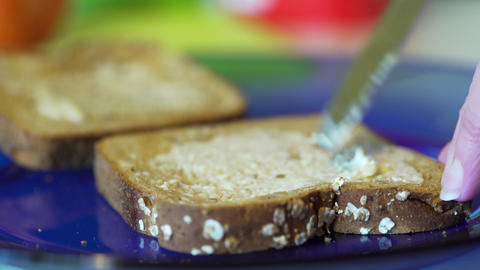 woman putting butter on two slices of toast 4k Footage