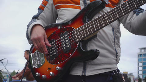 Bassist preparing for a concert in the open air Footage