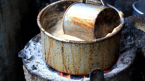 Indian tea with milk is prepared on an open fire Live Action