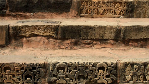 Steps of the ancient Indian temple, steps with facing of carved stone Footage