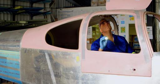 Engineer examining aircraft 4k Live Action