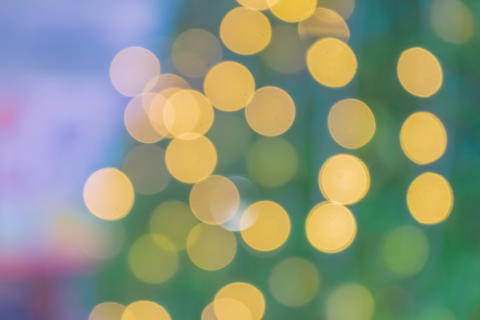 Abstract golden and light yellow bokeh from car lights Glittering Christmas and Photo