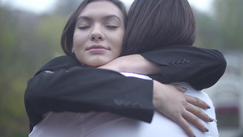 Young male and female hug each other outdoors Young couple spends time together Footage