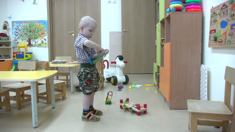 a boy plays the maze in kindergarten Footage