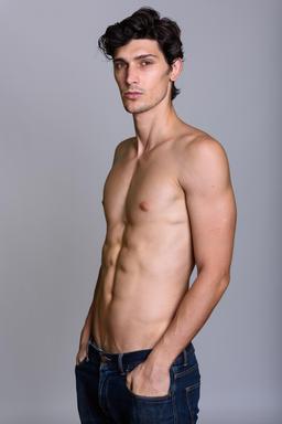 Studio shot of young handsome Brazilian man shirtless Photo