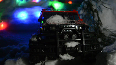 Red toy jeep in the snow Live Action