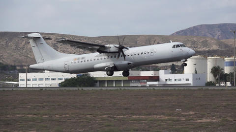 Military propeller plane taking off in slow-mo 영상물