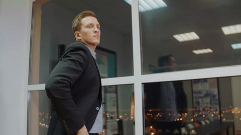 Serious businessman thinking about solve of business problem in evening office Footage