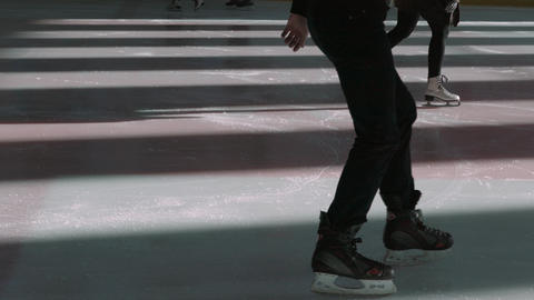 People Skate On Skating Rink GIF