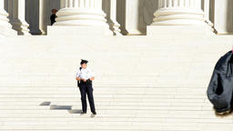 Washington DC, Police security officer guard, steps of Supreme Court Footage