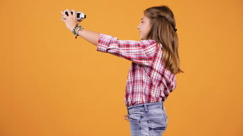Girl vlogging with a camcorder in hands Live Action